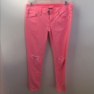 American Eagle distressed pink skinny jeans